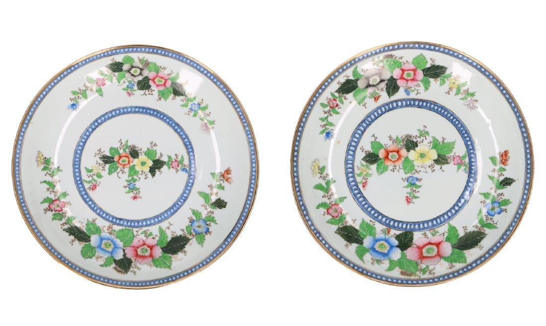 A lot of two polychrome porcelain plates with floral