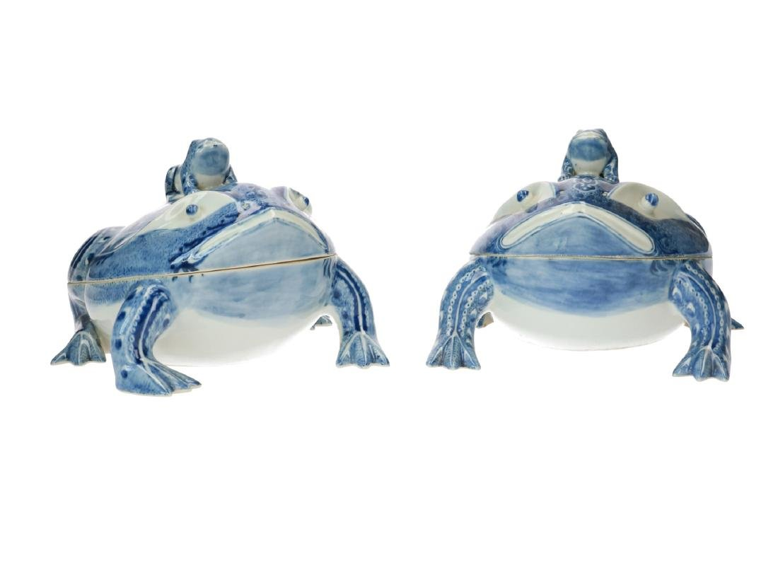 A pair of blue and white porcelain frog-shaped jars.