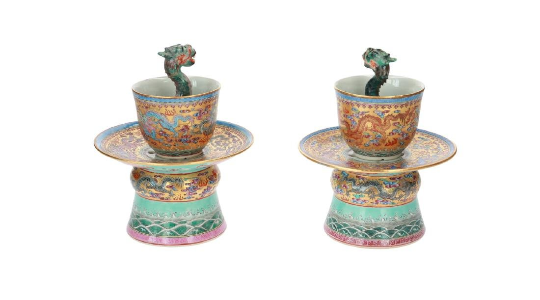 A lot of two polychrome porcelain dragon cups on stand.