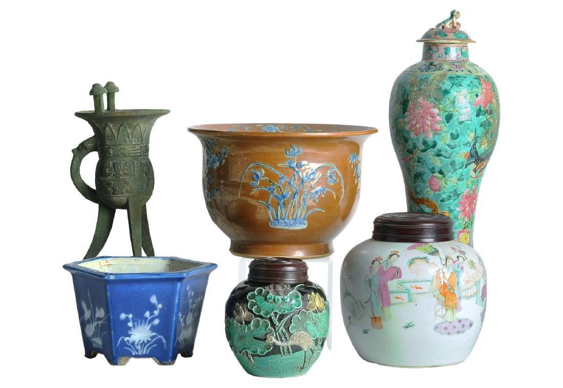 A various lot including porcelain cachepots, lidded