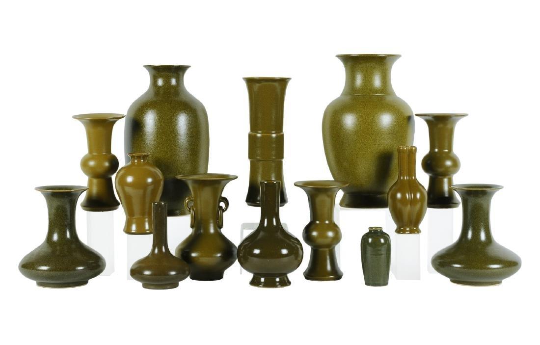 A lot of 14 tea-dust glazed porcelain vases. China,