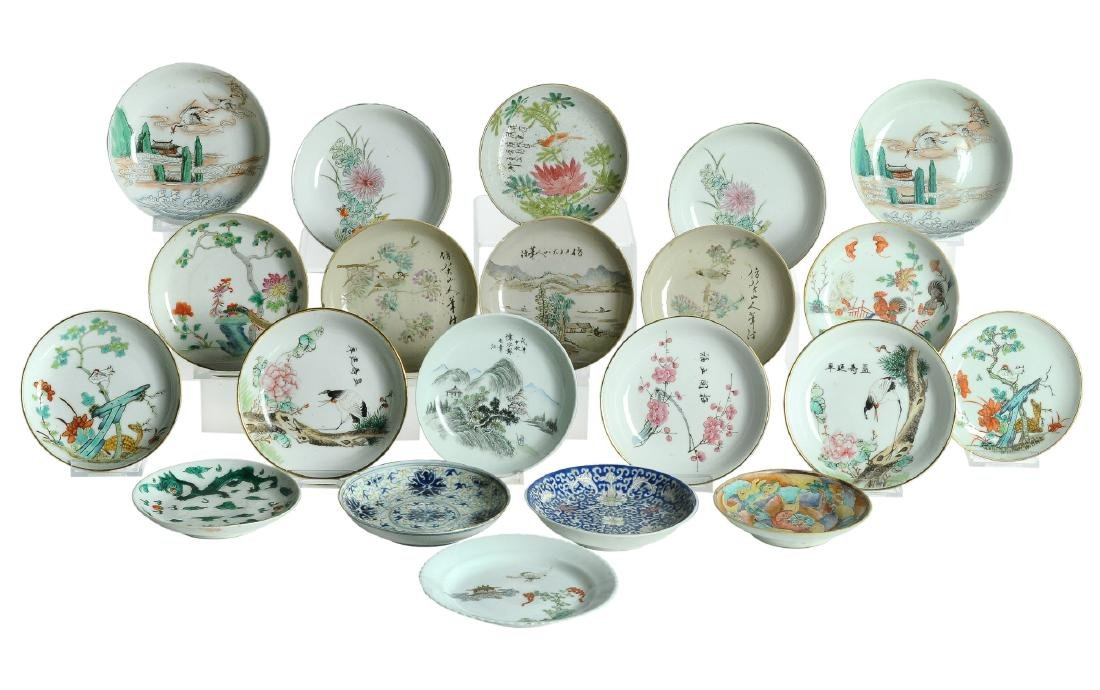 A lot of 21 polychrome porcelain saucers, decorations
