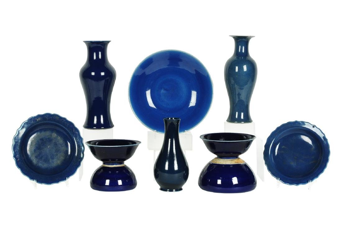 A lot of 10 blue glazed porcelain objects, including