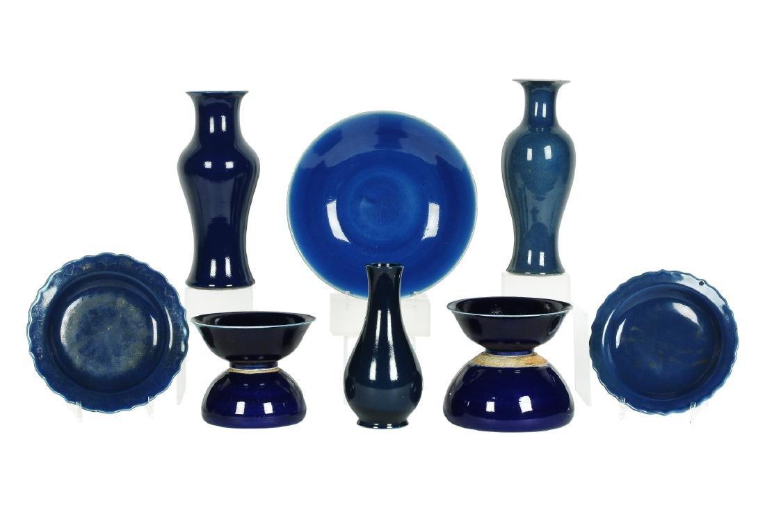 A lot of 10 blue glazed porcelain objects, including