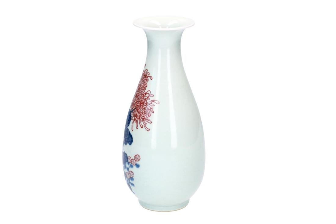 A blue and white with underglaze red porcelain vase,