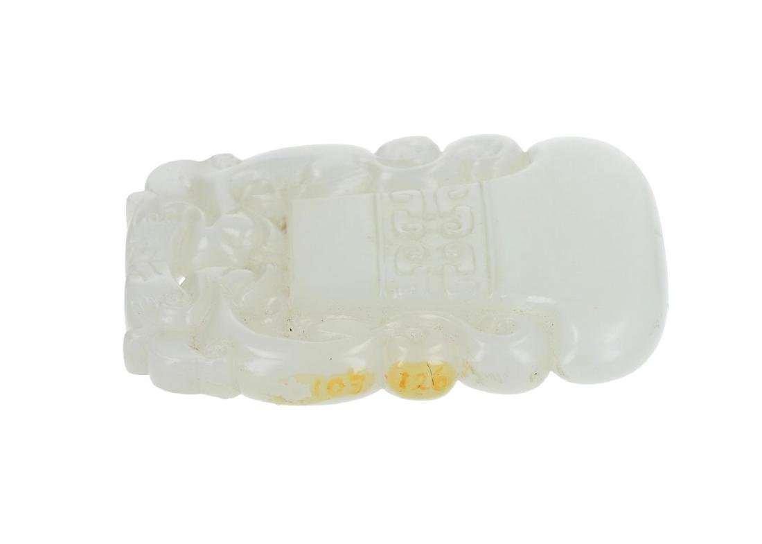 An ax-shaped white jade pendant with dragons. China, - 2