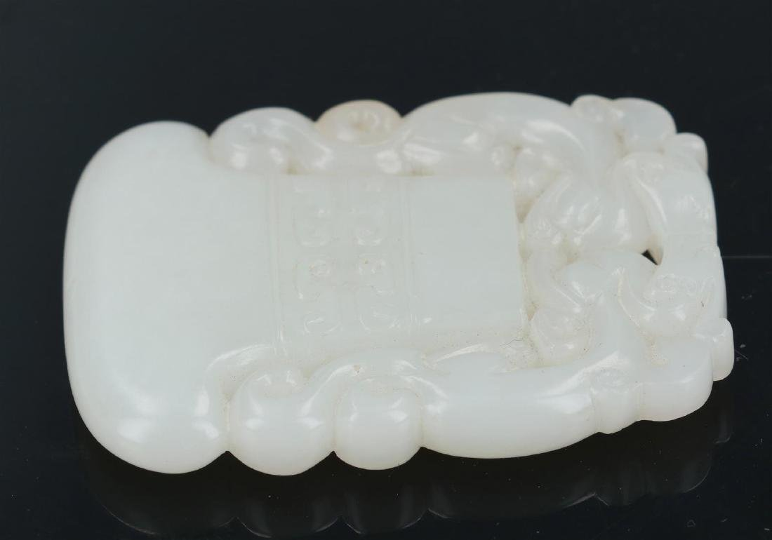 An ax-shaped white jade pendant with dragons. China, - 3