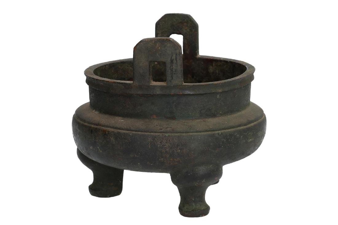 A bronze tripod censer with carved ring around the - 3