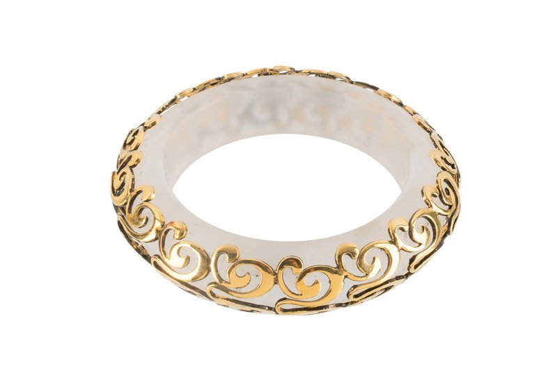 An Anonymous bracelet with goldtone mouth. Unsigned.