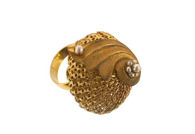 An Anonymous, lot of four; 1) goldtone ring with faux