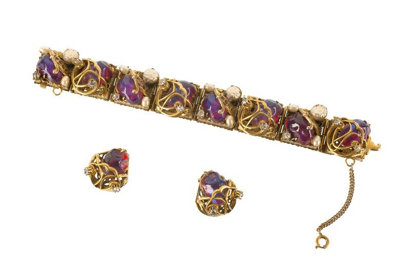 An Anonymous goldtone bracellet and pair of earclips,