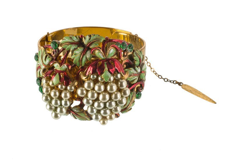 An Anonymous goldtone bracelet set with green stones,