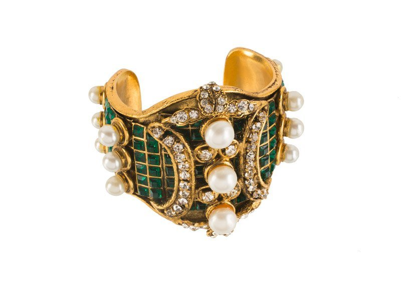 A Chanel goldtone cuff bracelet, set with green stones,