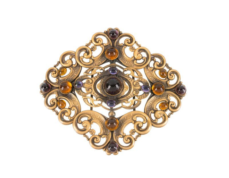 A Joseff Hollywood goldtone buckle, set with purple and