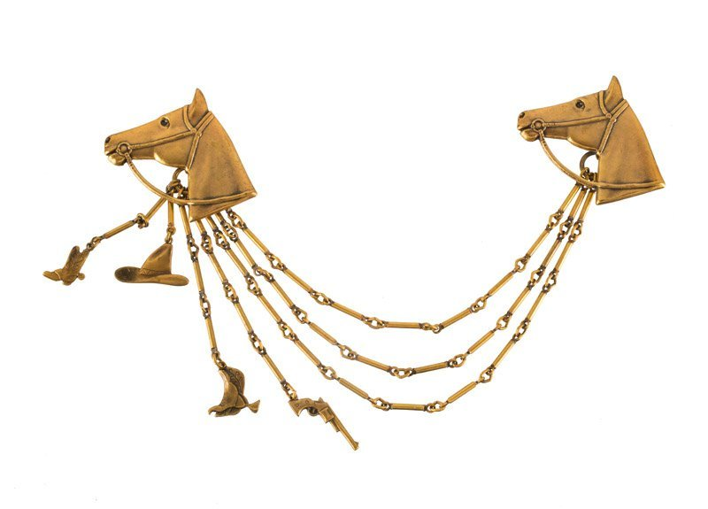 A Joseff Hollywood goldtone chatelaine with two horses'