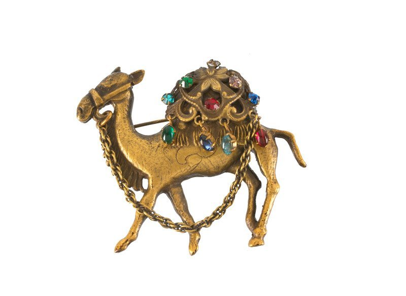 A Joseff Hollywood goldtone Camel shaped brooch, set
