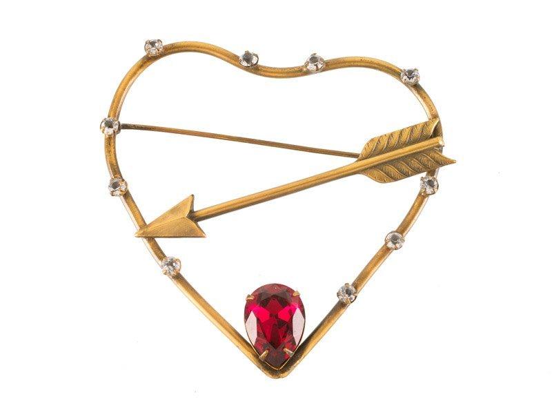 A Joseff Hollywood goldtone heart and arrow brooch, set