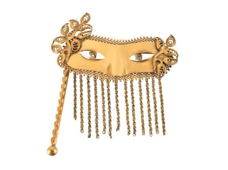 A Joseff Hollywood masquerade mask brooch, eyes set