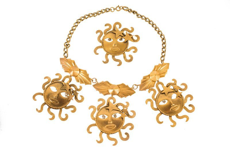 A Joseff Hollywood goldtone sun face necklace and