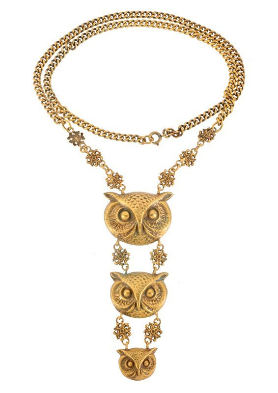A Joseff Hollywood goldtone necklace depicting three