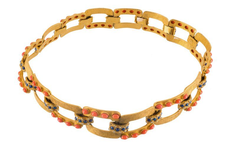 A Kenneth Jay Lane goldtone belt, set with rhinestones,