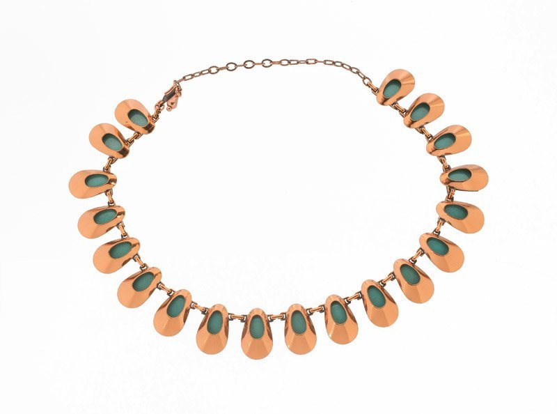 A Matisse goldtone necklace with green enamel. Signed