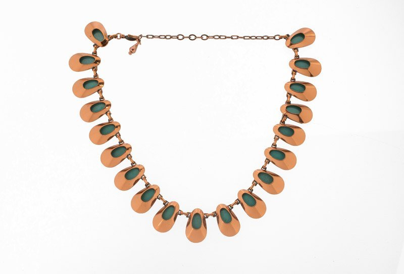 A Matisse goldtone necklace with green enamel. Signed - 2