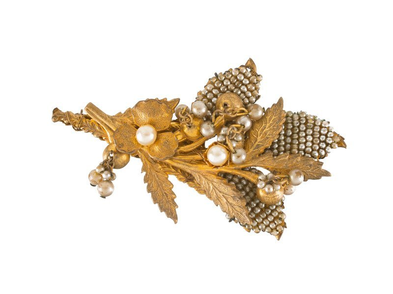 A Miriam Haskell faux pearl goldtone flower brooch.