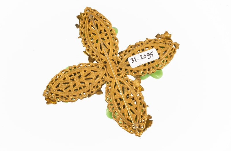 A Miriam Haskell goldtone brooch with floral motifs, - 3