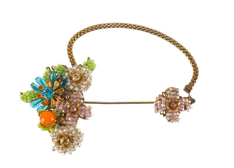 A Miriam Haskell goldtone flower pin brooch, set with