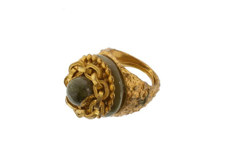 A Miriam Haskell goldtone and faux jade ring. Signed