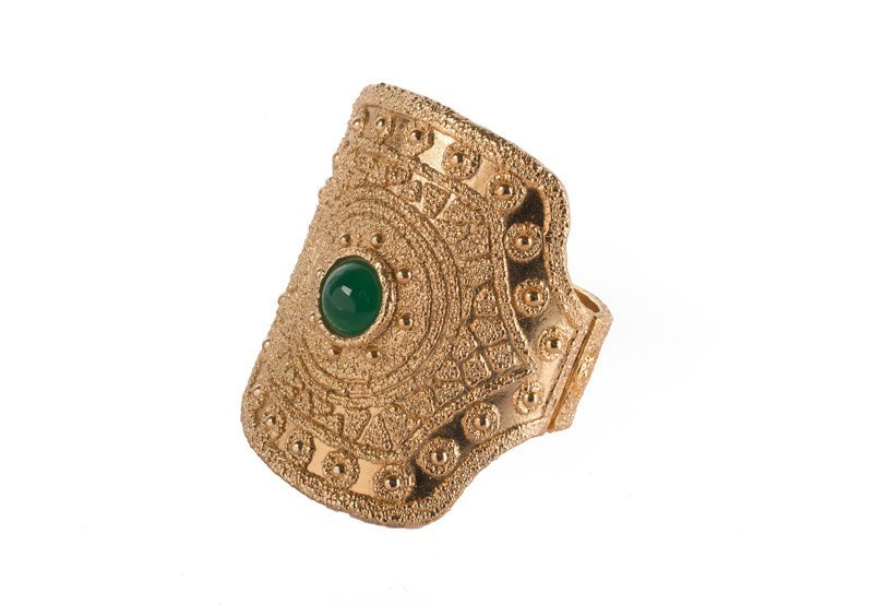 A Napier goldtone solid bracelet, set with a green - 4