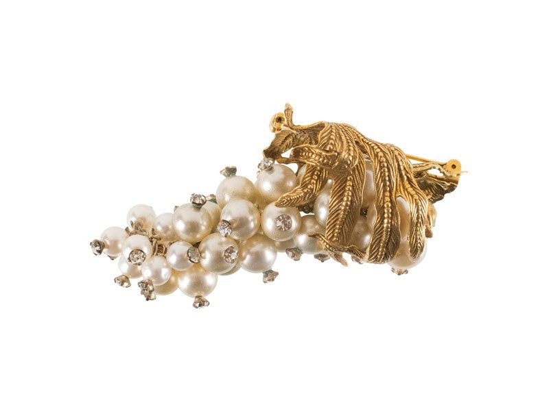 A Sandor Co. goldtone brooch, set with faux pearls and