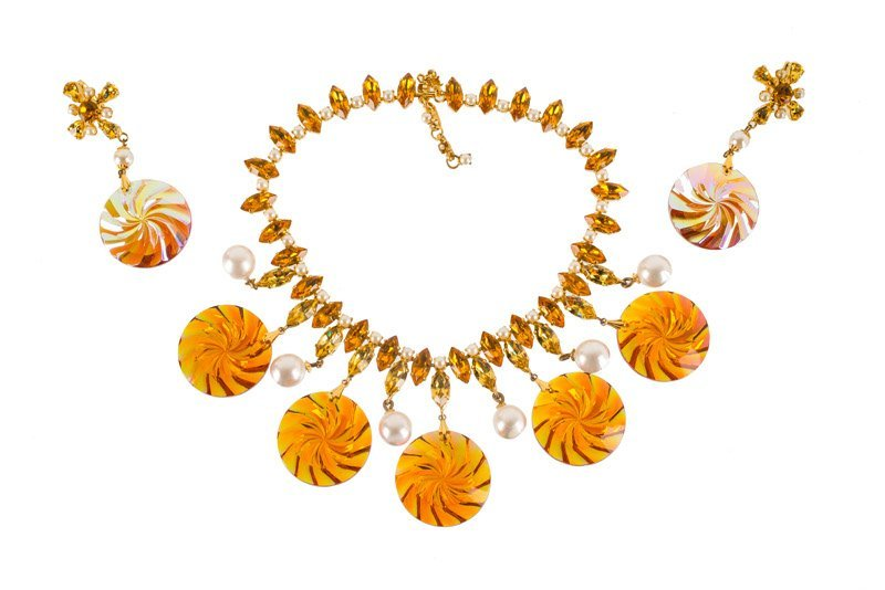 A Schreiner goldtone necklace and pair of earclips, set