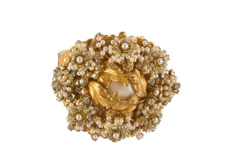 A Stanley Hagler goldtone bracelet, set with