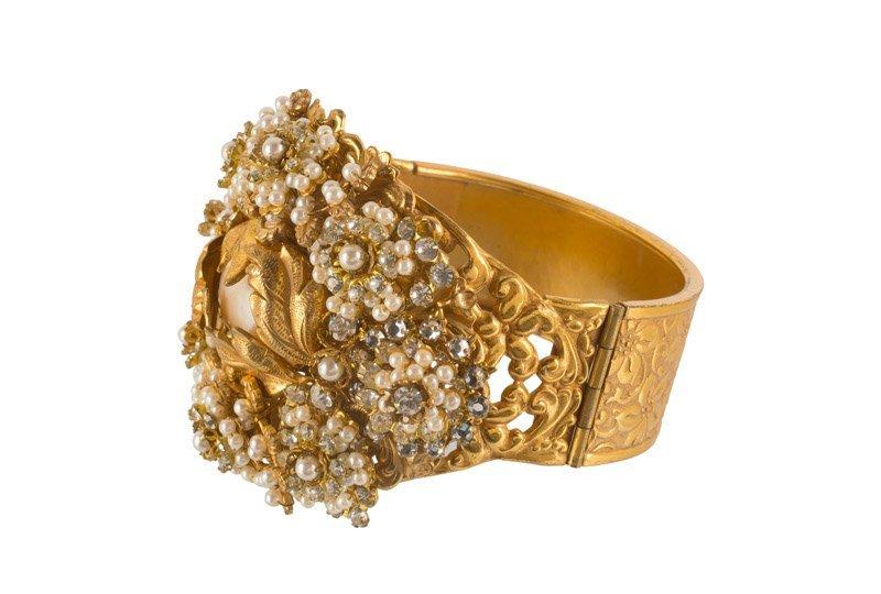 A Stanley Hagler goldtone bracelet, set with - 2