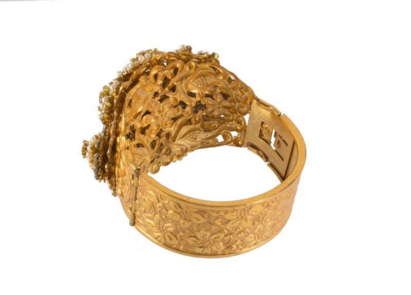 A Stanley Hagler goldtone bracelet, set with - 3