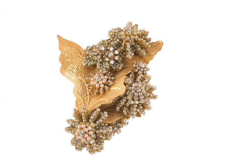 A Stanley Hagler goldtone floral brooch, set with
