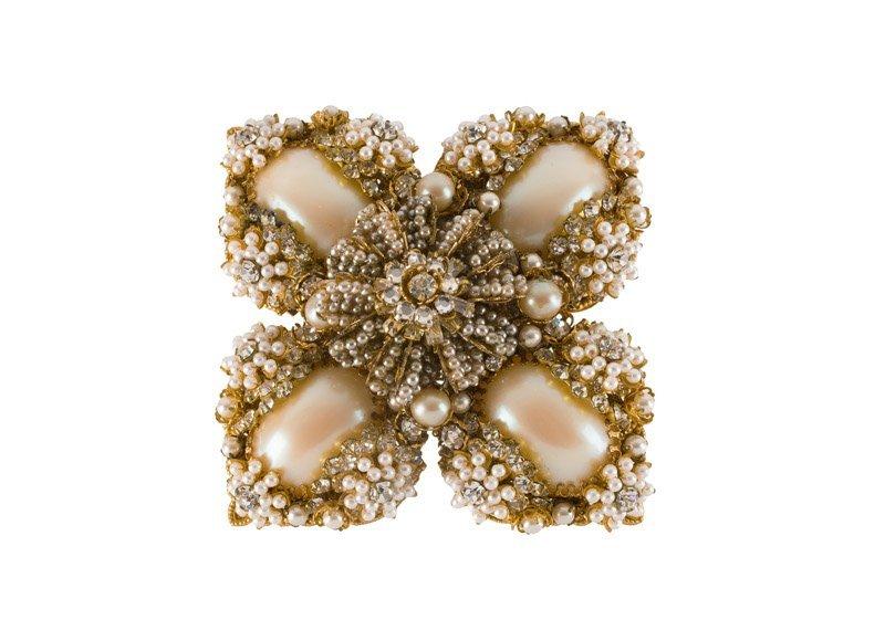 A Stanley Hagler goldtone brooch set with rhinestones