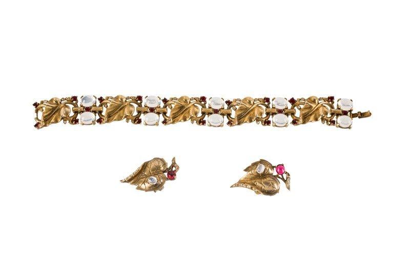 A Trifari goldtone bracelet and pair of earclips, set