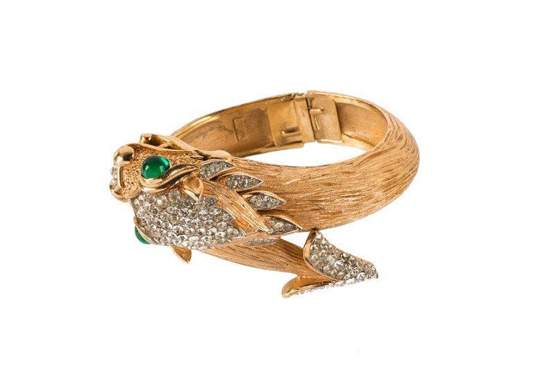 A Trifari goldtone bracelet with a dragon, set with