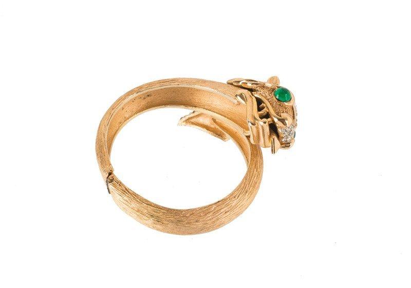 A Trifari goldtone bracelet with a dragon, set with - 2