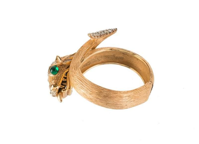 A Trifari goldtone bracelet with a dragon, set with - 3