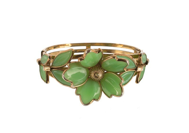 A Trifari goldtone bracelet set with green stones.