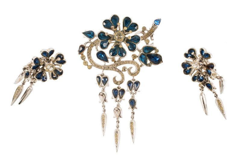 A Trifari silvertone brooch and pair of earclips, set