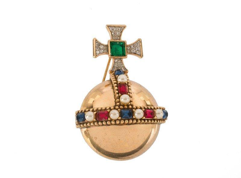 A Trifari goldtone brooch depicting an imperial orb,