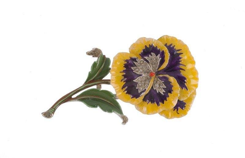 A Trifari silvertone floral brooch, set with