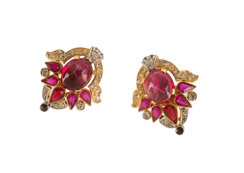 A Trifari goldtone pair of earclips, set with red
