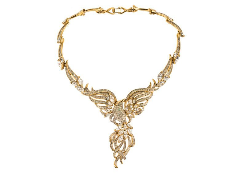 A Trifari goldtone necklace in the shape of a bird with