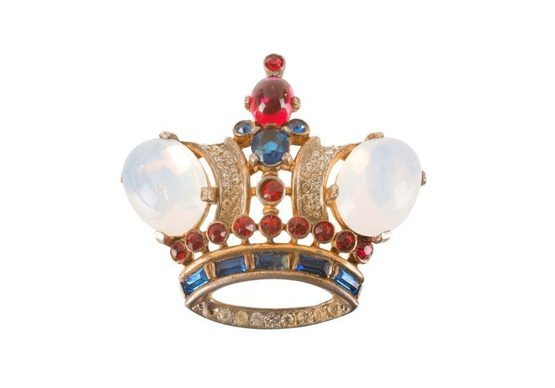 A Trifari sterling crown brooch, set with faux